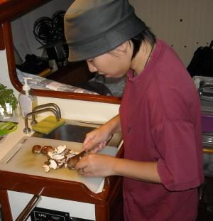 Lang working in the galley onboard S/V Calliste